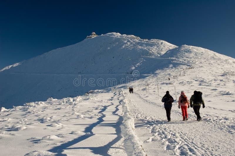 Winter mountains pilgrimage royalty free stock image
