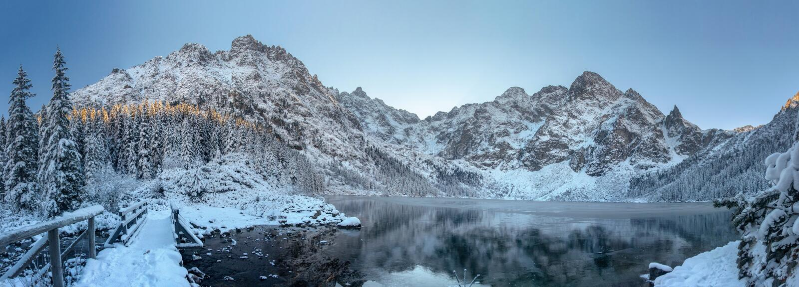 Winter mountains. Scenic frosty mountain landscape. Mountain icy lake. Winter panorama of Tatra mountains in Morskie Oko lake, royalty free stock photography