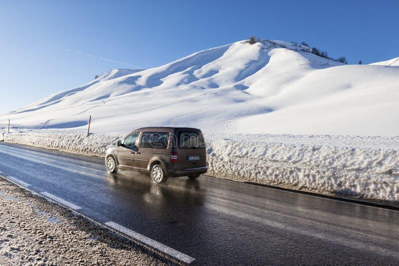 Winter moutain scenery, alpine road in Austrian, car speeding royalty free stock photos