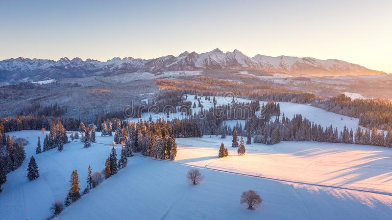 Winter nature aerial view. Sunrise in Tatra mountains, Poland. Beautiful mountain nature in morning sunlight stock photo