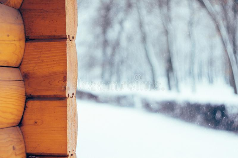 Winter nature background, landscape. Winter forest, park with snowy trees and corner of the wooden house. Winter weather; snow. Drifts. A lot of snow. Selective stock images