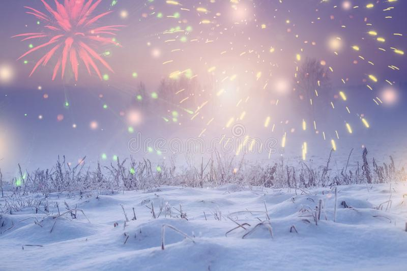 Winter nature landscape with festive lights for new year. Christmas at night with fireworks in dark sky royalty free stock image