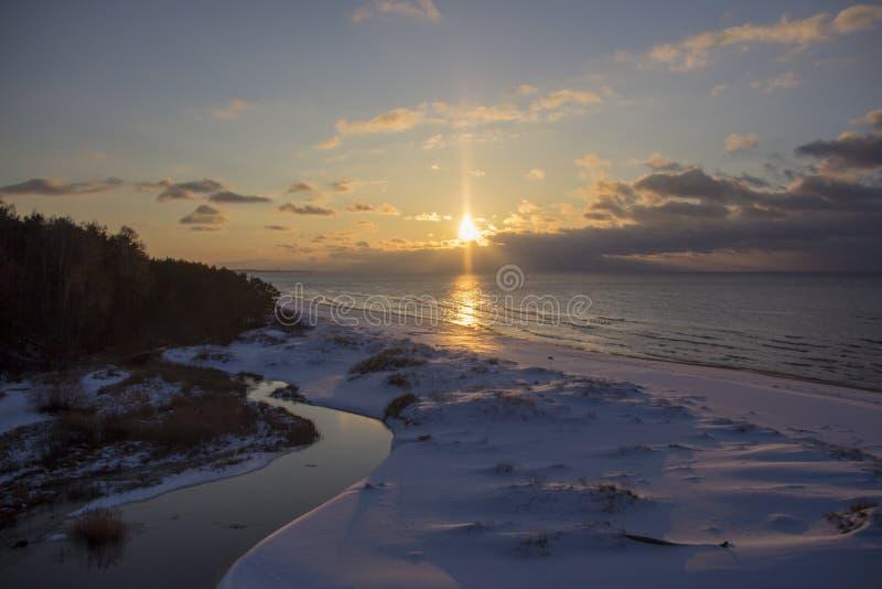 Winter sunrise snow baltic beach, latvia, saulkrasti stock images