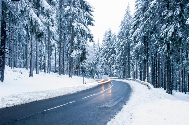 Snowy mountain road. Winter forest landscape. royalty free stock photos
