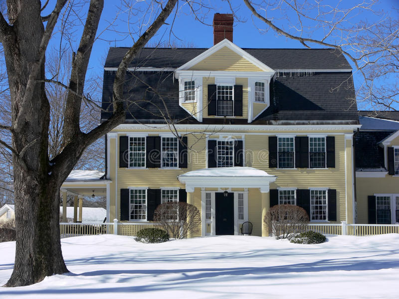 Winter: New England house in snow stock images