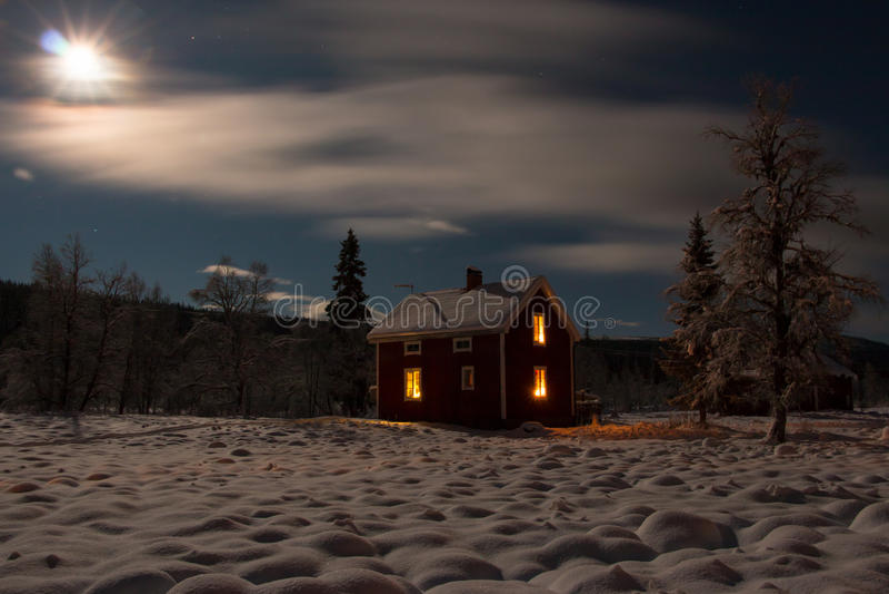 Winter night cabin stock photos