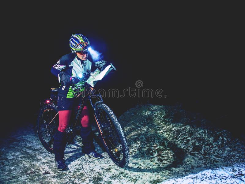 Winter night extreme bike racer control navigation and map stock photography