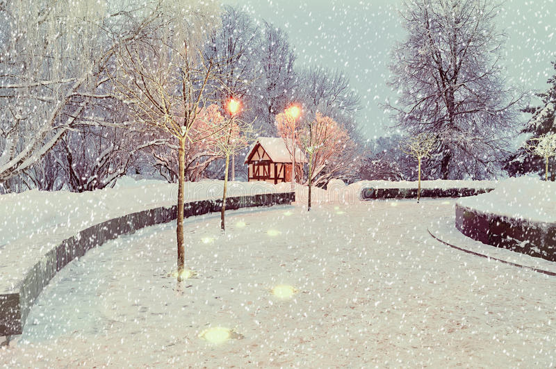 Winter night landscape with illuminated lonely house - winter landscape view royalty free stock photography