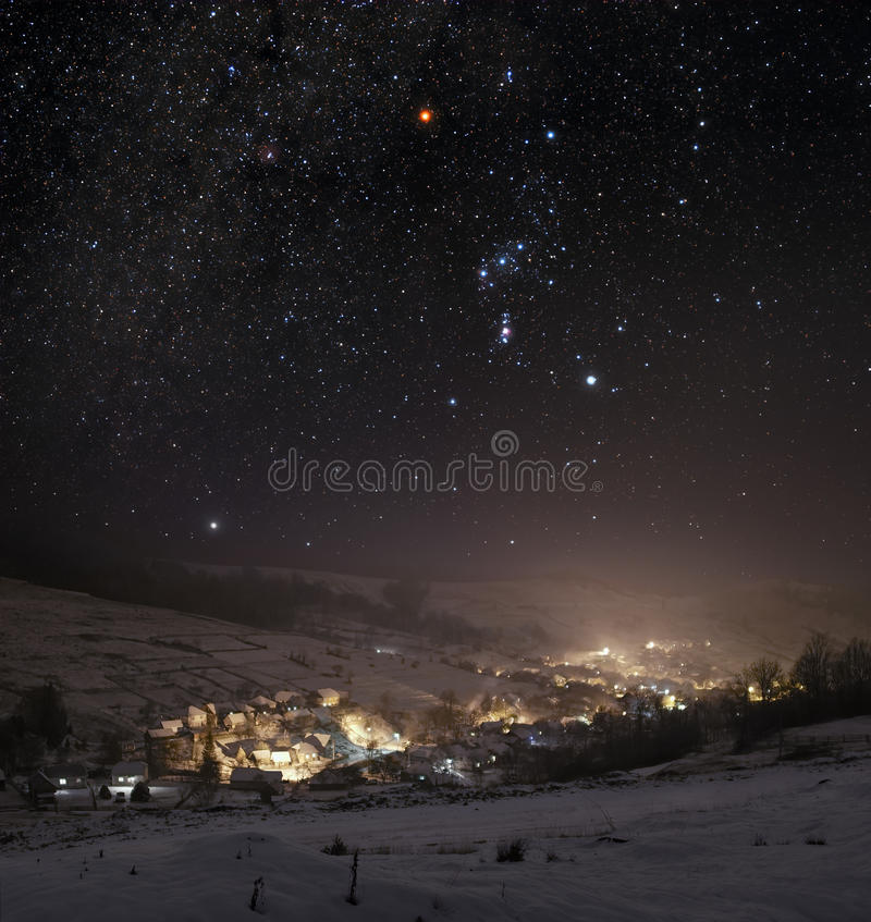 Winter night. Winter landscape of mountain town at night royalty free stock photos