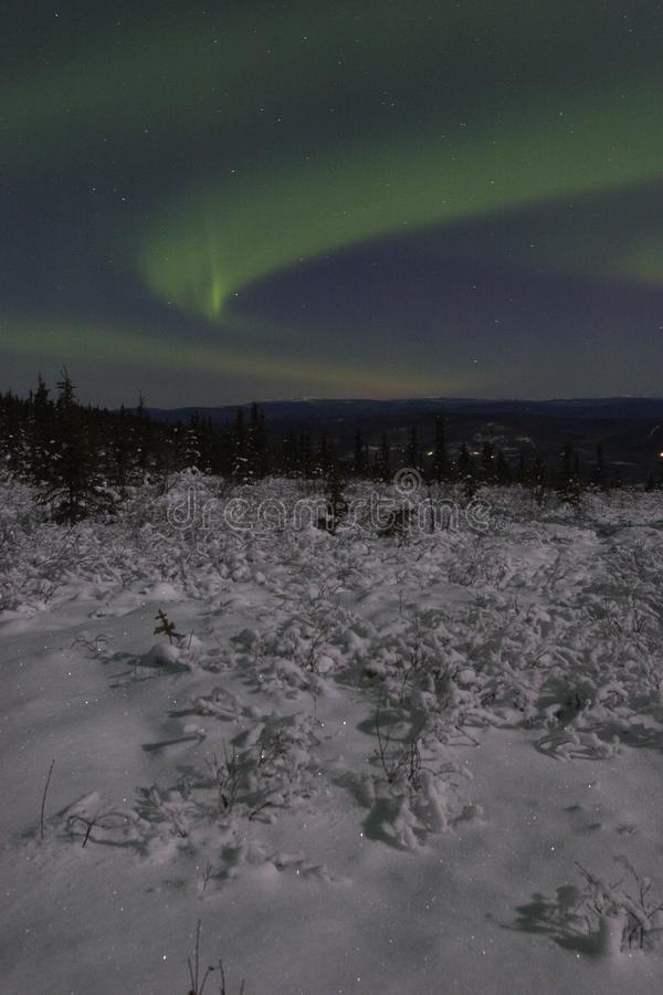 Winter night landscape with northern lights royalty free stock photos