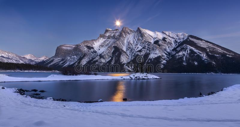 Full Moon over Lake Minnewanka in Banff National Park. Winter Night Landscape View of Full Moon over Lake Minnewanka in Banff National Park, Rocky Mountains royalty free stock photography