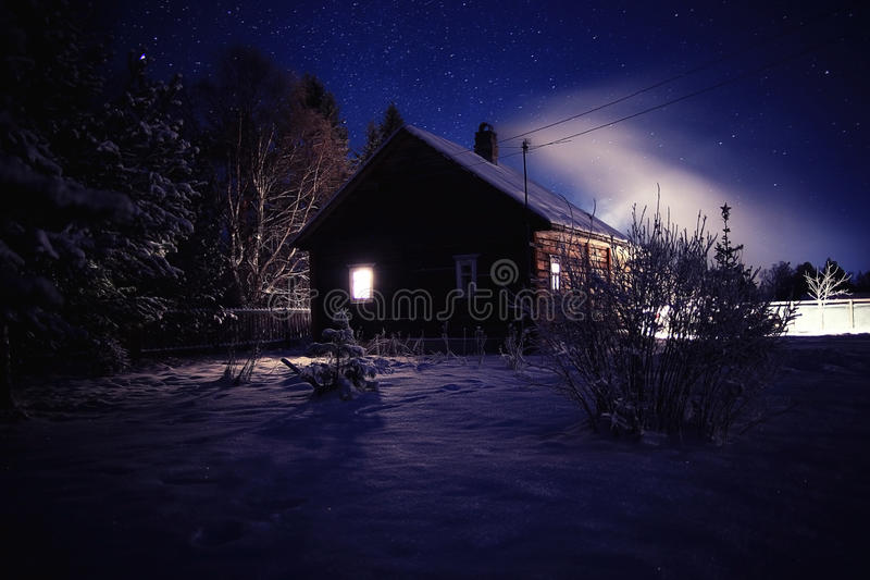 Winter night landscape in village stock image