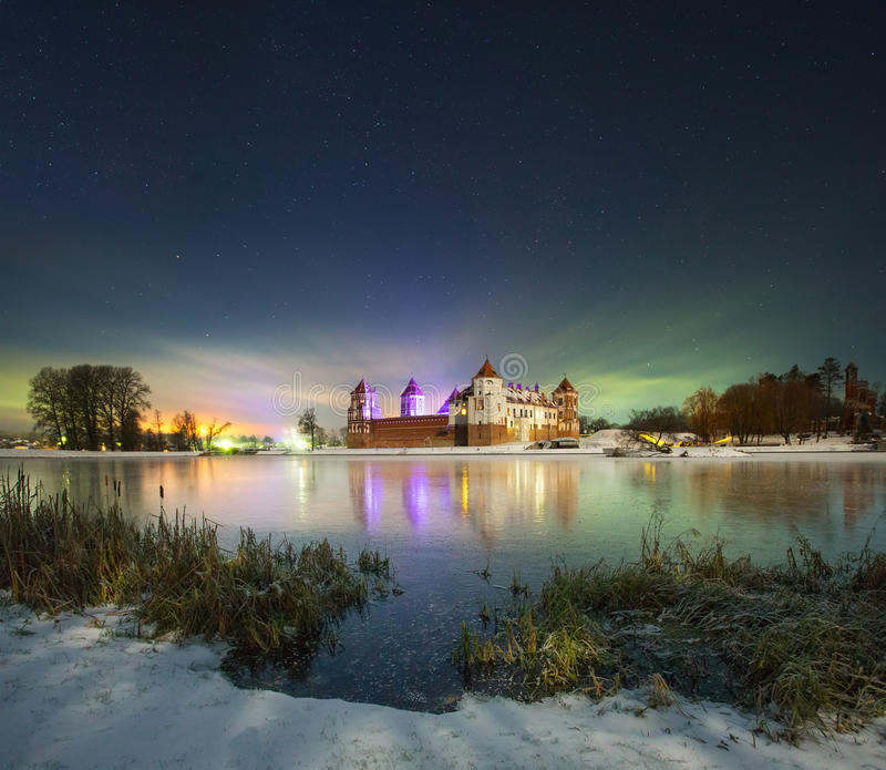Winter night near the castle royalty free stock image