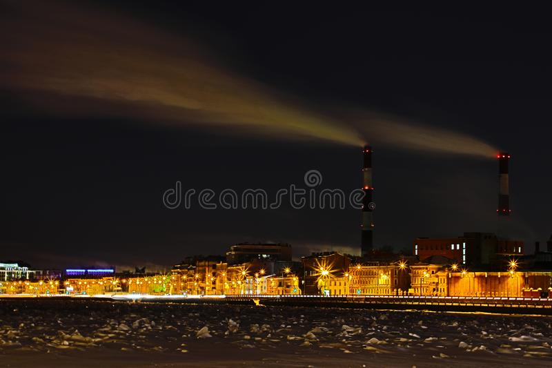 The winter night thermal power station on the Neva river embankment in Saint Petersburg royalty free stock image
