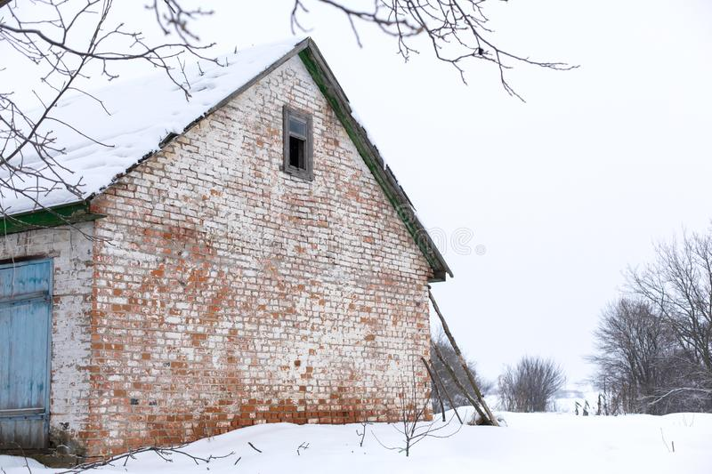 Winter, old dilapidated barn. A lot of snow around.  royalty free stock images
