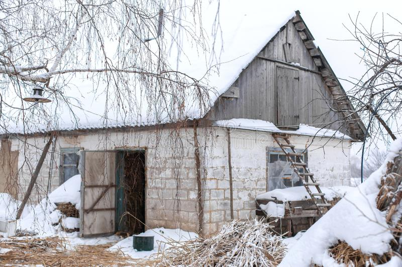 Winter, old dilapidated barn. A lot of snow around.  stock image