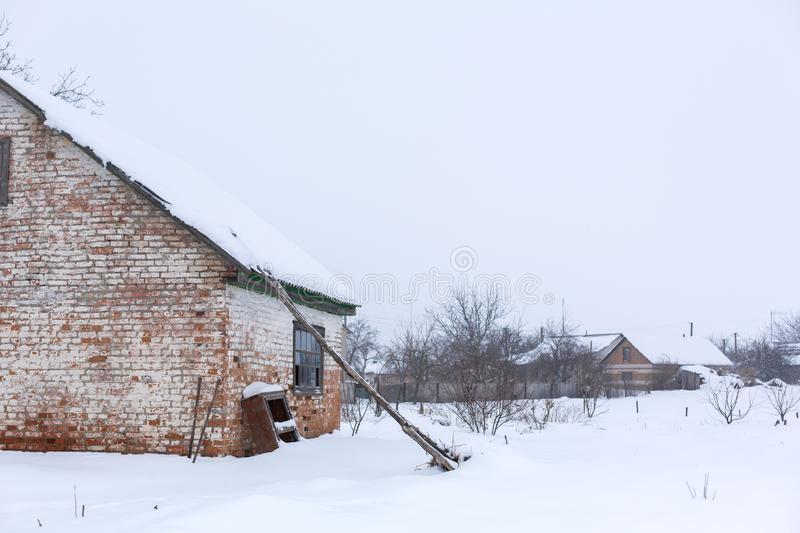 Winter, old dilapidated barn. A lot of snow around.  royalty free stock photography
