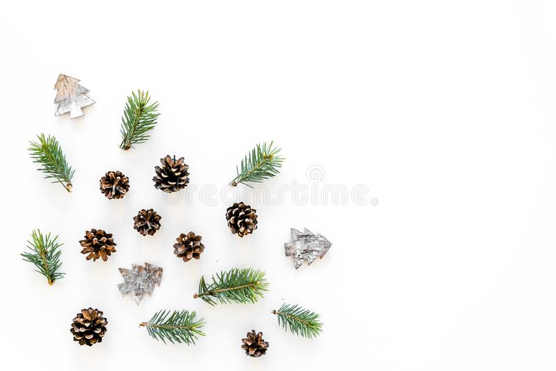 Winter ornament, New Year pattern. Pine sprigs, cones, spruce figure, fir oil on white background top view copy space stock photo