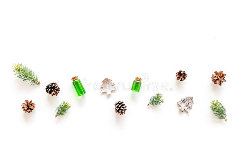 Winter ornament, New Year pattern. Pine sprigs, cones, spruce figure, fir oil on white background top view copy space royalty free stock photography