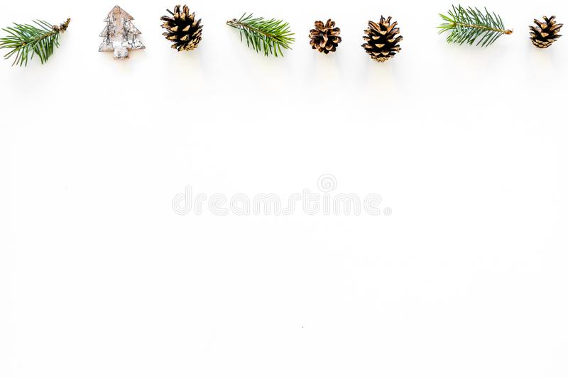 Winter ornament, New Year pattern. Pine sprigs, cones, spruce figure, fir oil on white background top view copy space stock photos