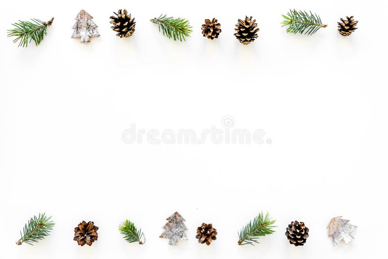 Winter ornament, New Year pattern. Pine sprigs, cones, spruce figure, fir oil on white background top view copy space stock photography