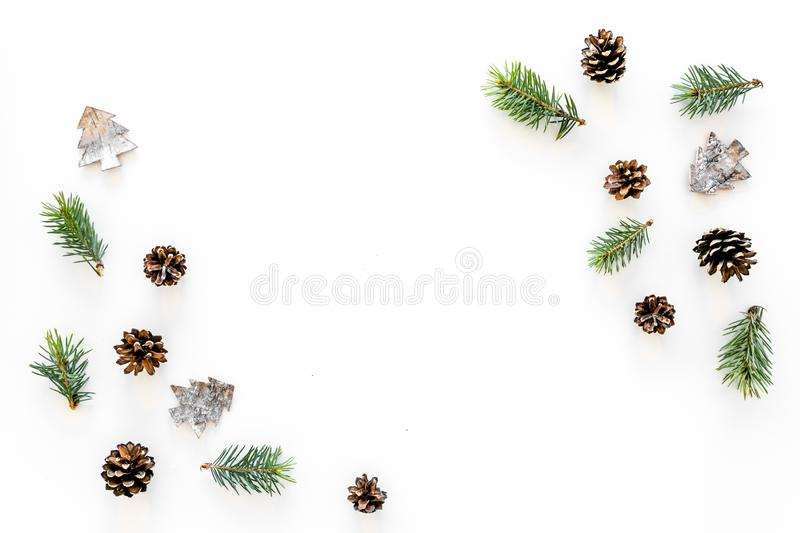 Winter ornament, New Year pattern. Pine sprigs, cones, spruce figure, fir oil on white background top view space for royalty free stock images
