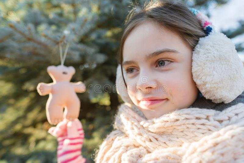Winter outdoor portrait of child girl near the Christmas tree stock photography