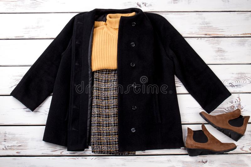 Winter outfit with black cashmere coat. royalty free stock images