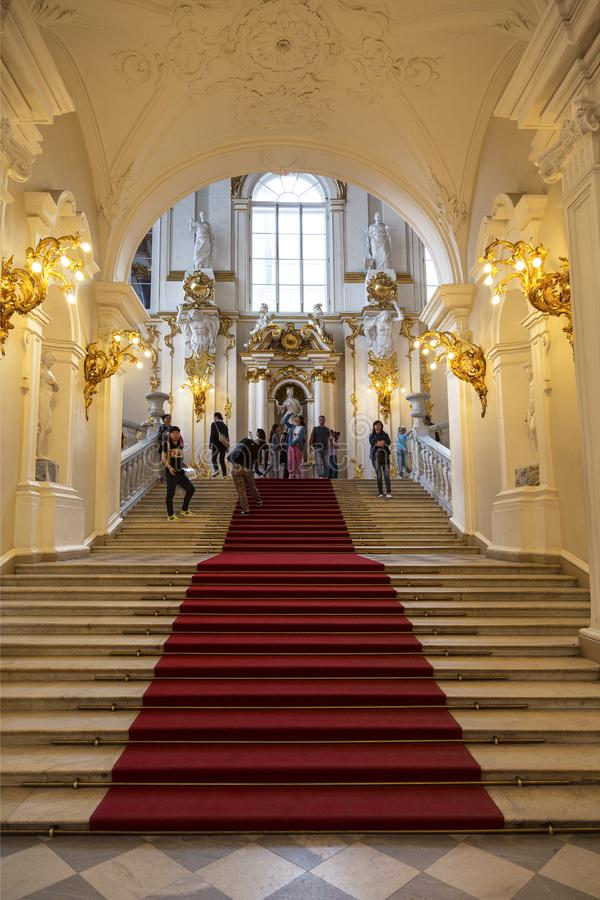 Winter Palace. Tourists in the interior of the main parad Jordanian staircase. Saint-Petersburg, Russia stock images