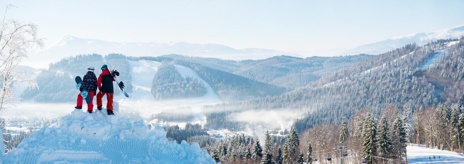 Winter panorama of Carpathians mountains landscape and forests with snowboarders. Winter panorama of the Carpathians mountains landscape and forests in a white royalty free stock photography