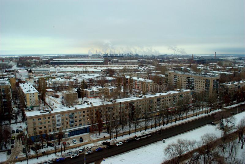 Winter panorama of the city of Tolyatti overlooking residential areas and smoking chimneys of chemical plants. Winter panorama of the Central district of the stock image