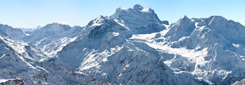 Winter panorama of high alpine mountains horizontal background royalty free stock image