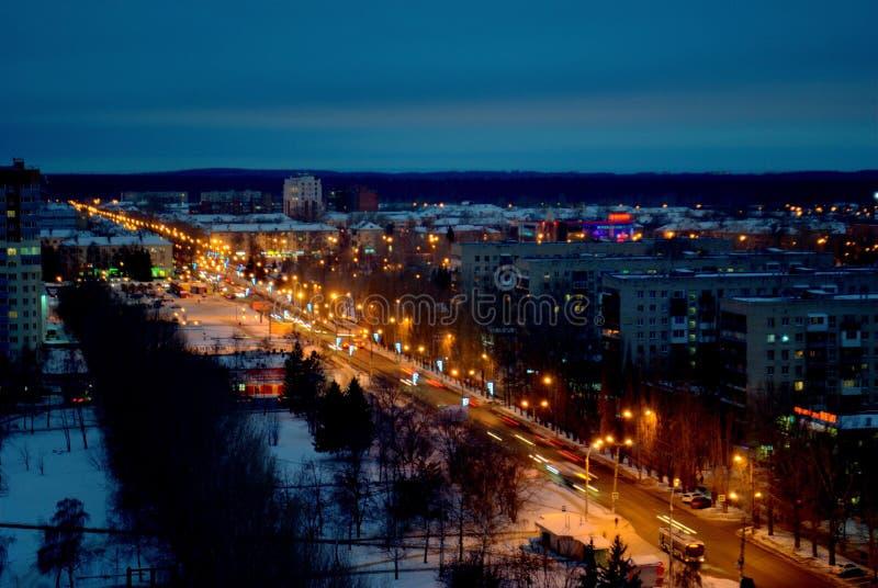 Winter panorama of the night city with a view of Mira Street. Togliatti, Samara region, Russia - December 4, 2018: Winter panorama of the night city with a view stock photography