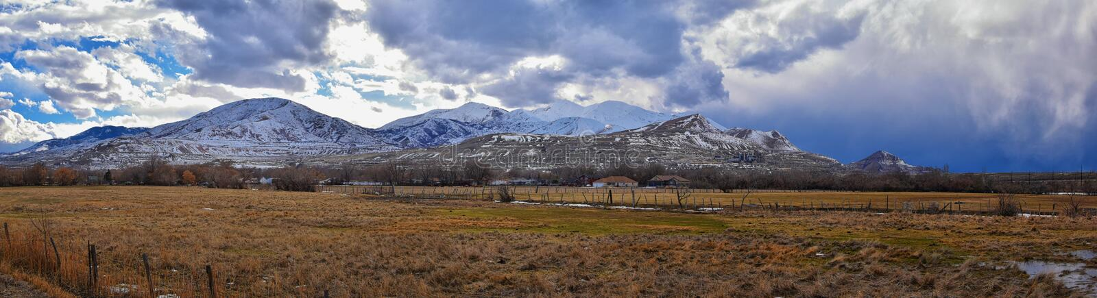 Winter Panorama of Oquirrh Mountain range snow capped, which includes The Bingham Canyon Mine or Kennecott Copper Mine, rumored th. E largest open pit copper stock photography
