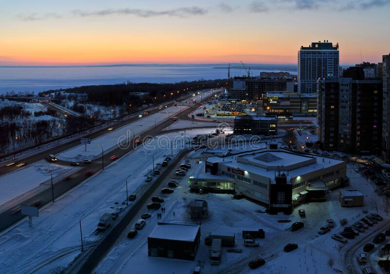 Winter panorama overlooking Sportivnaya Street, the embankment of the frozen Volga River, residential buildings and the Vega Hotel. Togliatti, Samara region stock photography