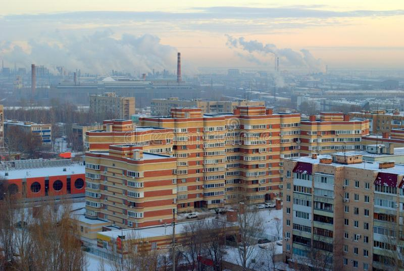Winter panorama of residential areas of the city of Togliatti and smoking chimneys of chemical plants. royalty free stock photos