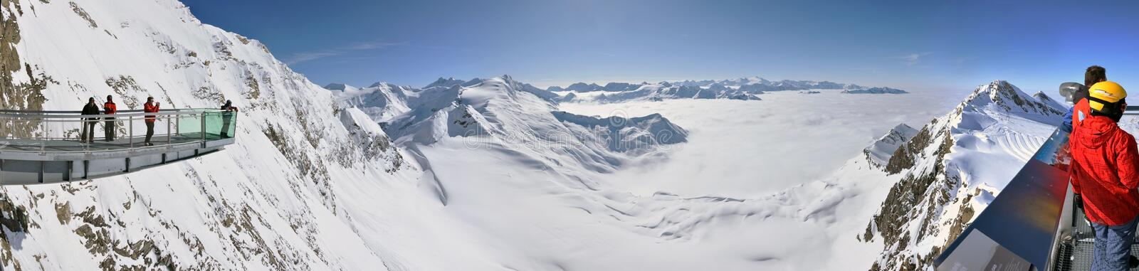 Winter panorama with skiers