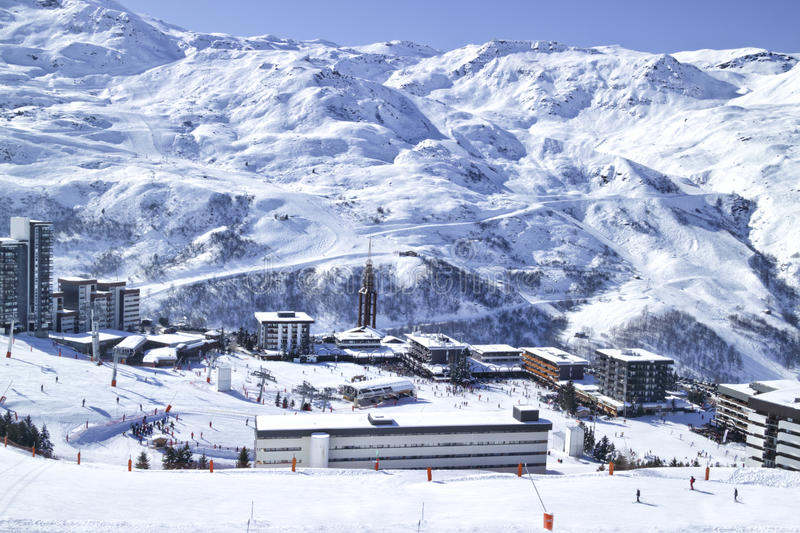 Winter panoramic view of French ski resort village in Alps. Les Menuires, Alps, France, February 08 2015: Winter Snowy High mountain panorama of French ski stock photo