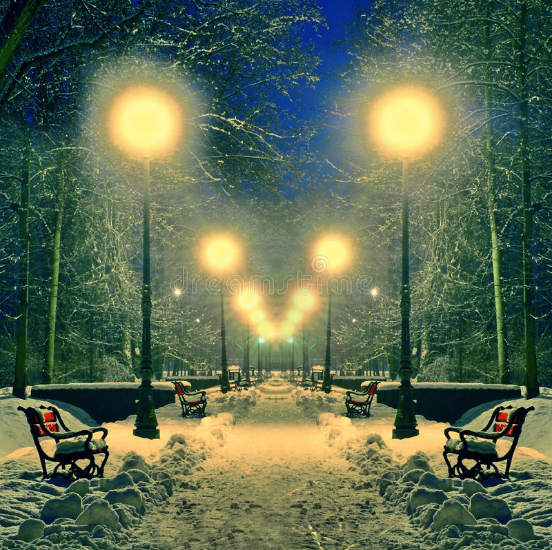 Winter park covered with snow with lamps