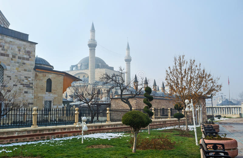 The winter park in Konya. The Mevlana Museum, surrounded by the scenic flower beds and tiny park, Konya, Turkey royalty free stock photography
