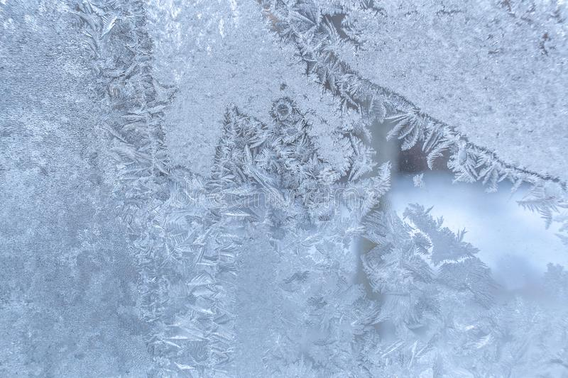 Winter pattern at window glass as Christmas or New Year background. stock images