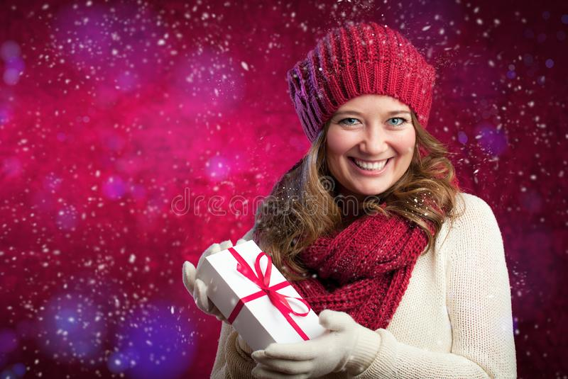 Portrait of a sweet girl with a red scarf Christmas, close-up royalty free stock image