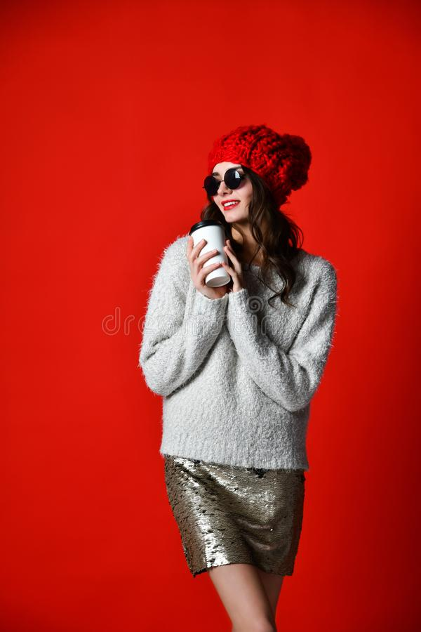 Winter, people, happiness, drink and fast food concept - woman in hat with takeaway tea or coffee cup royalty free stock image