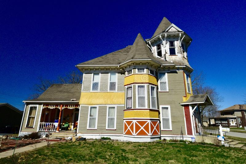 Colorful Queen Anne. This is a Winter picture of a colorful house located in Arcola, Illinois in Douglas County. This three-story framed house is an example of royalty free stock photo