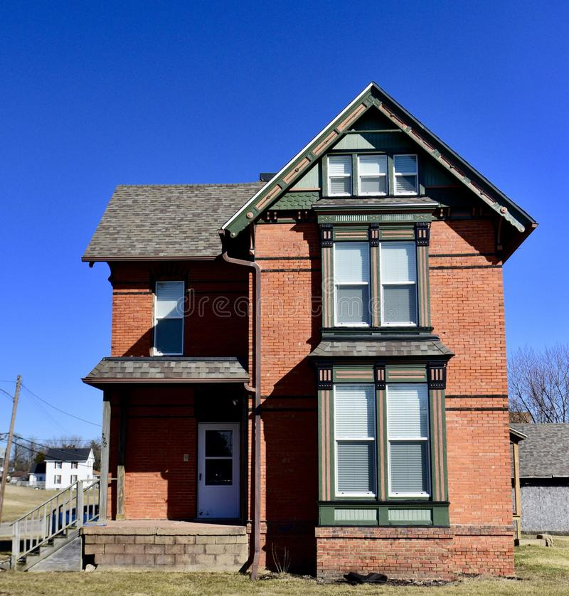 Brick Italianate. This is a Winter picture of a house in Kewanee, Illinois in Henry County. This three-story brick house is an example of Italianate architecture royalty free stock photo