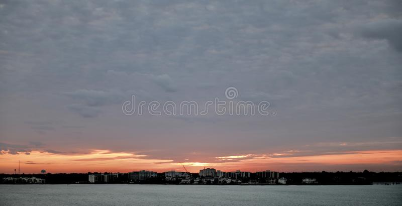 Rising Sun Over Largo. This is a Winter picture of a rising sun over Clearwater Harbor and Largo, Florida in Pinellas County. This picture was taken on February stock photos