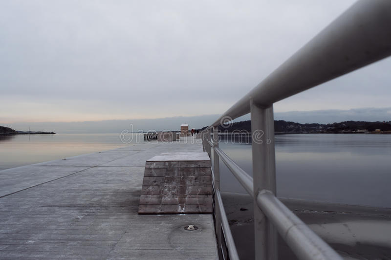 Winter pier deep perspective royalty free stock photography