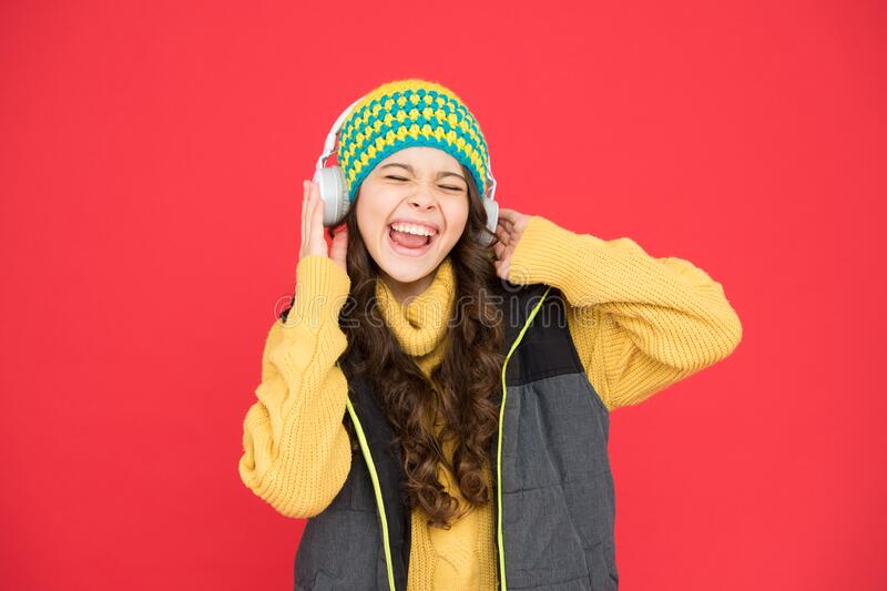 Winter playlist. Entertain herself by being creative. Recording studio. Beautiful voice. Developing voice. Small girl. Listen music headphones. Hobby concept royalty free stock photography