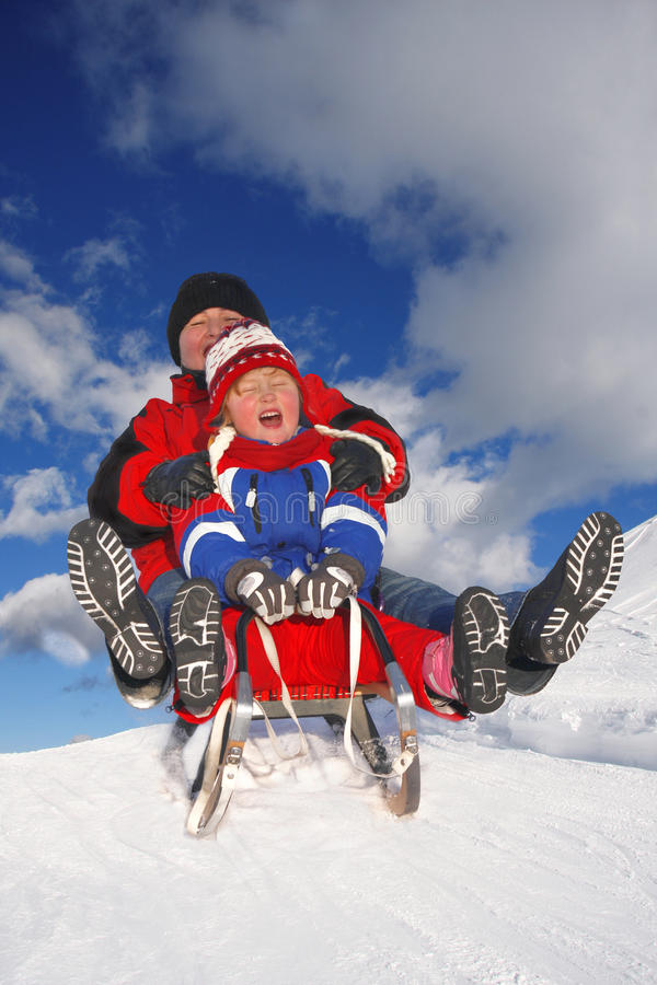 Winter pleasures on the sled royalty free stock photos