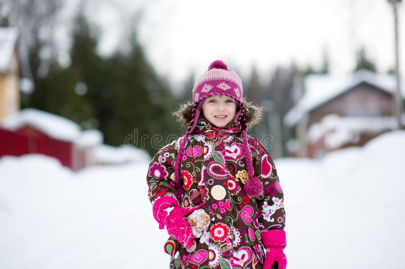 Winter portrait of adorable child girl in jumper stock photo